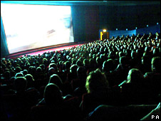 Audience in a cinema auditorium watching a film