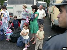 Families from South Ossetia outside buses bound  for Russia
