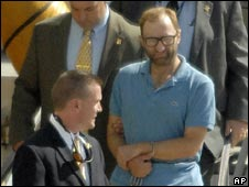 Clark Rockefeller arrives handcuffed in Boston