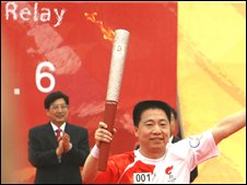 Chinese Athlete starts the Olympic Torch relay in Beijing