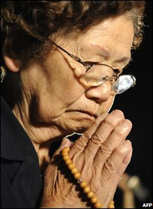 A woman prays at the Peace Memorial Park in Hiroshima, Japan