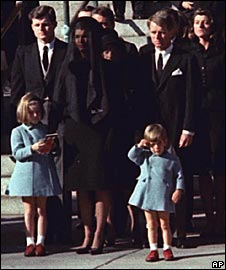 John Kennedy Jnr salutes his father's coffin