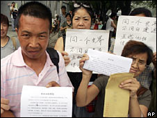 Petitioners wait outside a petition office in Beijing on 9 July 2008