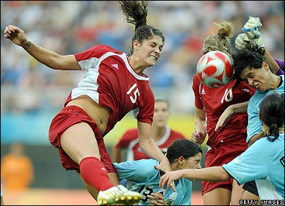 Kara Lang of Canada (L) vies with opponents from Argentina