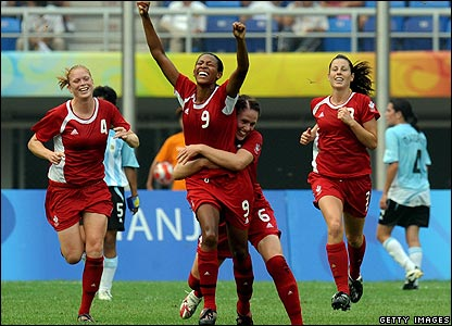 Candace Chapman of Canada celebrates with her team-mates after scoring against Argentina