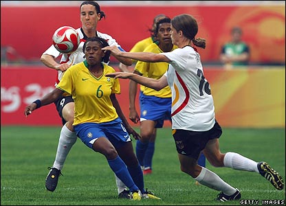 Maycon of Brazil is surrounded by German shirts during the Group F match in Shenyang
