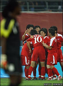 North Korea's Kim Kyong Wa celebrates scoring with team-mates