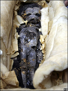 One of the two mummified foetuses during preparations for a DNA test in Cairo, Egypt, 6 August 2008