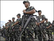 Philippine soldiers stand in formation at army headquarters in Manila on 27 July