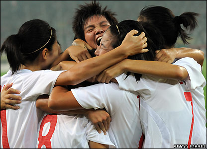 Yan Xu (C) of China celebrates after scoring in the first round match against Sweden in Tianjin