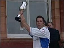 Bobby Dawson lifts the MCCA Trophy