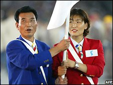 "North and South Korean athletes marching under ""unity flag"" at Athens Olympics 2004 opening ceremony"
