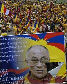 A poster of Dalai Lama torn during scyffle between the police and Tibetans in Kathmandu, Nepal, 7 August, 2008.