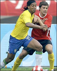 Brazil captain Ronaldinho takes on Belgium's Sepp de Roover