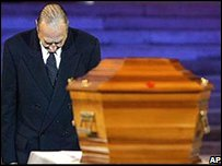 French President Jacques Chirac bows at the coffin of author Alexandre Dumas