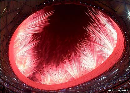 The first batch of an estimated 20,000 fireworks light up Beijing's night sky