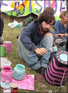 A camper prepares for a colourful parade to the power station