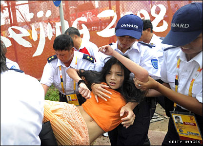 A protester is removed by police