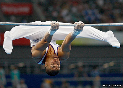 British teenager Louis Smith competes on the high bar during the artistic gymnastics