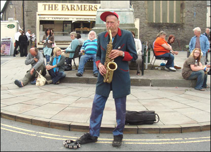 Busker Nik Turner entertained the early arrivals