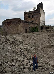 Man in bomb crater in Gori, 8 Aug 08