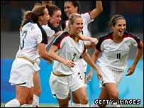 USA celebrate Carli Lloyd's winner
