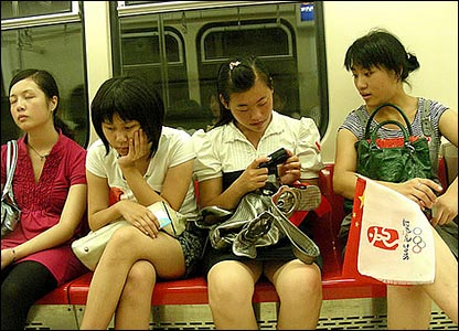 The days's events appear to have taken their toll on these fans on the Beijing subway