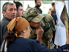 People read a list of casualties in Gori, Georgia, on 9 August