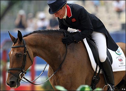 Great Britain's Mary King riding on Call Again Cavalier reacts after her dressage event