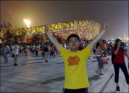 Qiyuan Li celebrates outside the Olympic Stadium