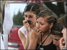 Georgian girls in the town Gori examine a casualty list, 8 August 2008