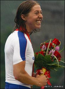Nicole Cooke celebrates gold on the podium at the Olympics
