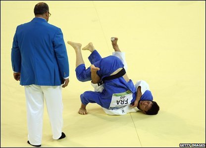 Masato Uchishiba (white) of Japan throws Benjamin Darbelet of France