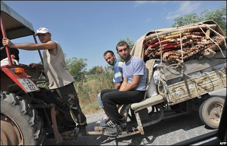 People flee on a tractor with their belongings in South Ossetia near the village of Troiavi, 10 August 2008