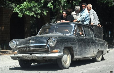 People flee on an old Soviet-built car in South Ossetia near the village of Troiavi, 10 August 2008