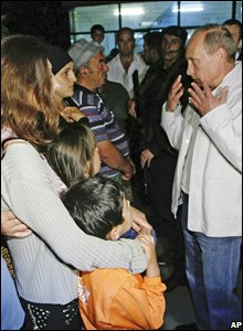 Russian Prime Minister Vladimir Putin speaks with South Ossetian refugees who fled to Vladikavkaz, the provincial capital of the Russian region of North Ossetia, 9 August 2008