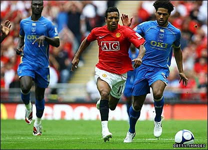 Manchester United's Nani bursts through