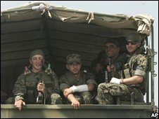 Georgian soldiers look from a truck as they head to the town of Gori, just outside the breakaway province of South Ossetia