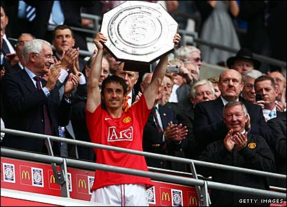 Manchester United captain Gary Neville lifts the Community Shield