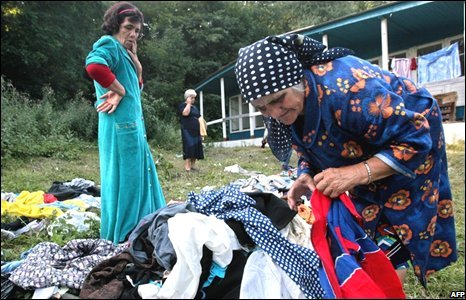A woman from South Ossetia sorts through her belongings in the refugees camp near the village of Alagir near the Georgian border