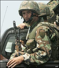 Georgian soldier looks from a vehicle while heading to the town of Gori, Georgia
