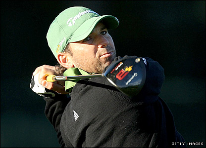 Sergio Garcia plays his tee shot on the sixth hole