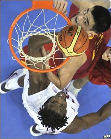China's Yao Ming and the US' Chris Bosh during the US-China basketball game