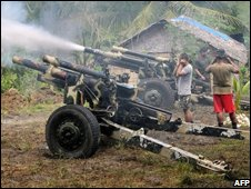 Army troops fire a 105 mm Howitzer canon into  MILF areas in North Cotabato Province, 11th Aug