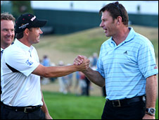 Padraig Harrington is congratulated by Nick Faldo