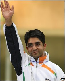 "Gold winner Abhinav Bindra of India celebrates on the podium following the men""s 10m air rifle shooting finals"