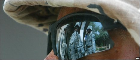 Reflection in soldier's glasses, AFP
