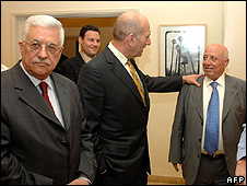 Mahmoud Abbas, and Ehud Olmert with his hand on Ahmed Qurei's shoulder