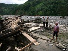 Villages look at the rubble of 19 houses after a flash flood in Lao Cai province on 11 August 2008