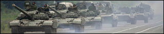A column of tanks and other armored vehicles roll near the town of Alagir on the road to the border of the Georgian breakaway region of South Osseti